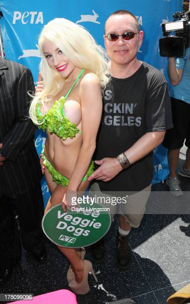 TV personality Courtney Stodden poses in a lettuce leaf bikini for PETA with her husband actor Doug Hutchison at Hollywood Highland Center on July 31...