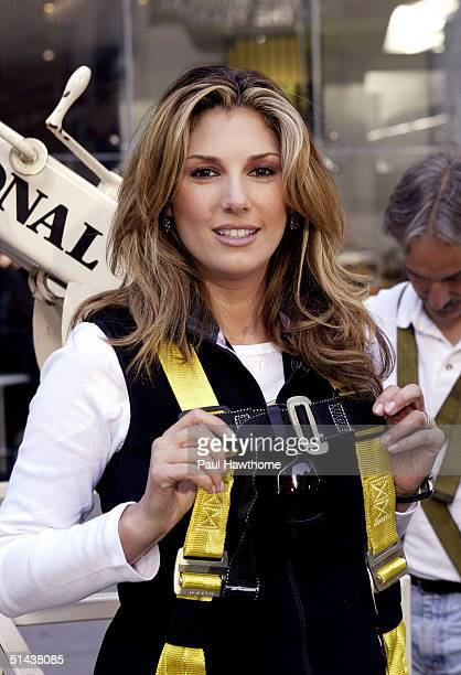 TV personality Daisy Fuentes poses for a photo after putting the last pink PostIt note on the world's largest pink ribbon made of PostIt notes in...