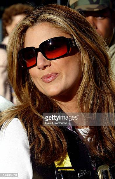TV personality Daisy Fuentes poses for photos before placing the last pink PostIt note on the world's largest pink ribbon made of PostIt notes in...