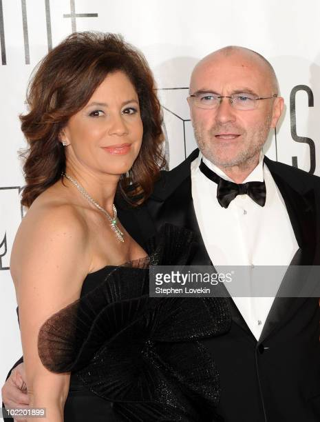 TV personality Dana Tyler and singer/songwriter Phil Collins attend the 41st annual Songwriters Hall of Fame at The New York Marriott Marquis on June...