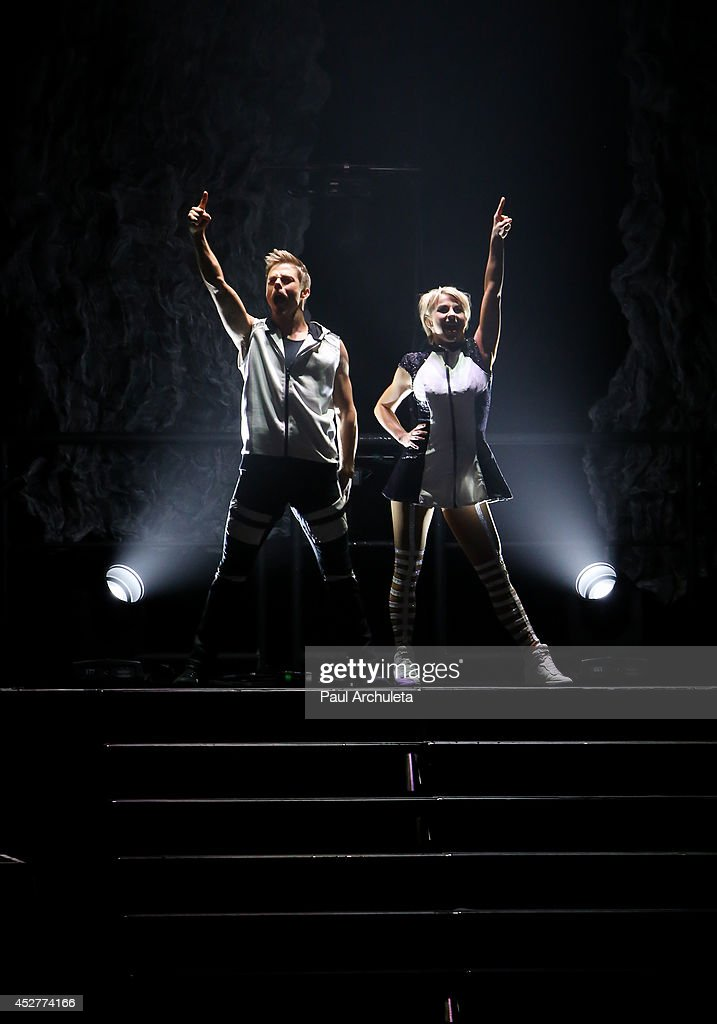 TV Personality / Dancers Derek Hough (L) and Julianne Hough (R) perform in the 'Move Live On Tour' concert at the Orpheum Theatre on July 26, 2014 in Los Angeles, California.