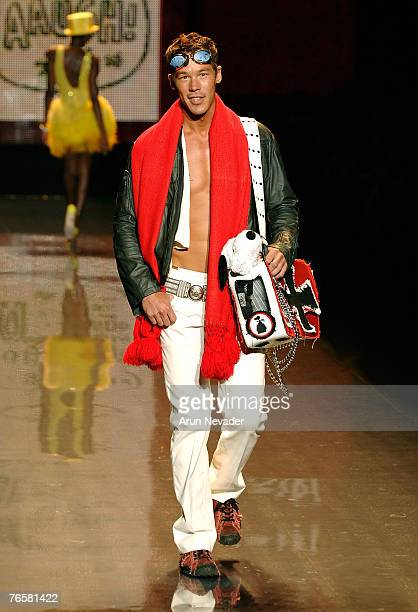 Personality David Bromstad walks the runway wearing Snoopy In Fashion during MercedesBenz Fashion Week at the Tent Bryant Park on September 7 2007 in...