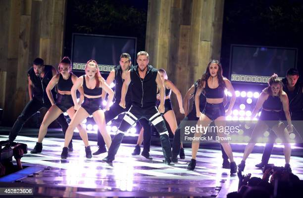 Personality Derek Hough performs onstage at the 2014 Young Hollywood Awards brought to you by Samsung Galaxy at The Wiltern on July 27 2014 in Los...