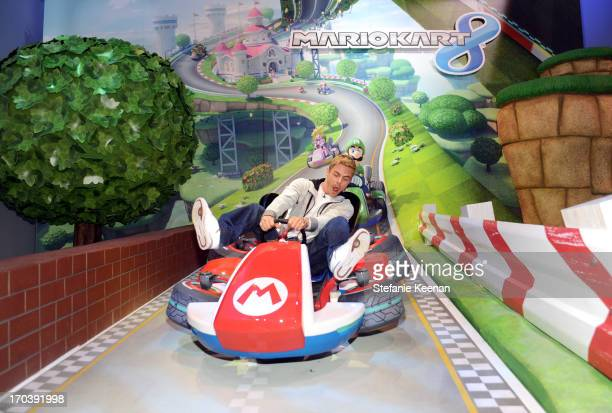 TV personality Derek Hough visits the world of Mario Kart 8 available for Wii U in December while attending Nintendo's booth at the 2013 E3 Gaming...