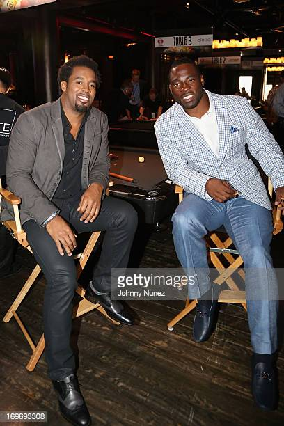 Personality Dhani Jones and NY Giants Justin Tuck attend the NY Giants Justin Tuck's 5th Annual Celebrity Billiards Tournament on May 30 2013 in New...
