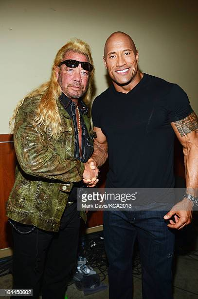 TV personality Dog the Bounty Hunter and actor Dwayne Johnson pose backstage at Nickelodeon's 26th Annual Kids' Choice Awards at USC Galen Center on...