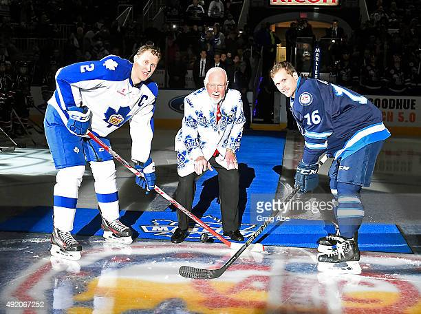 NHL personality Don Cherry drops the puck with Andrew Campbell of the Toronto Marlies and John Albert of the Manitoba Moose prior to a game on...