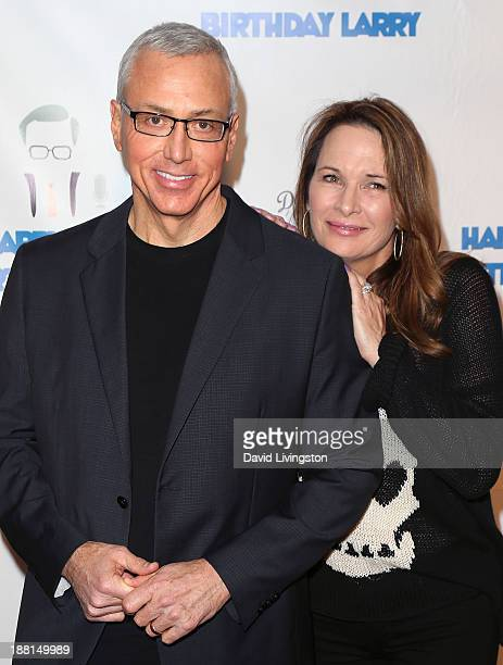 TV personality Dr Drew Pinsky and wife Susan Pinsky attend Larry King's 80th birthday surprise party at Dodger Stadium on November 15 2013 in Los...