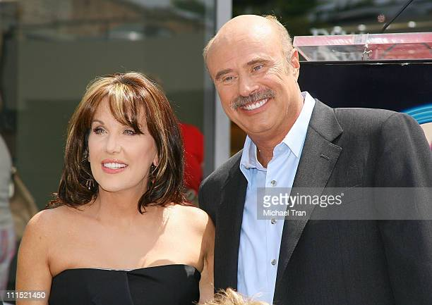 TV personality Dr Phil McGraw and wife Robin McGraw attend the Star on Hollywood Walk of Fame honoring country music duo Brooks Dunn held in front of...