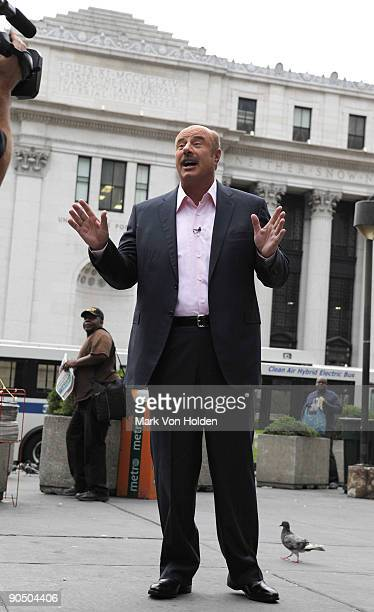 TV personality Dr Phil McGraw talks outside of Penn Station before boarding an Acela express train to Philadelphia during the taping of Phil Hits the...
