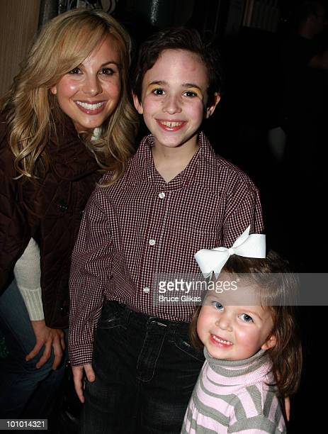 Personality Elizabeth Hasselback Actor Trevor Braun and Grace Hasselback pose as they visit backstage at The Little Mermaid on Broadway at The Lunt...
