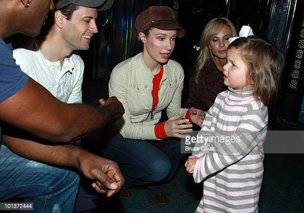 Personality Elizabeth Hasselback poses with Norm Lewis Sean Palmer Sierra Boggess and daughter Grace Hasselback as she visits backstage at The Little...