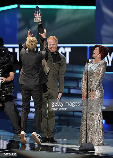 TV personality Ellen DeGeneres accepts the Favorite Daytime TV Host award from presenters Jesse Tyler Ferguson and Sharon Osbourne at the 2012...