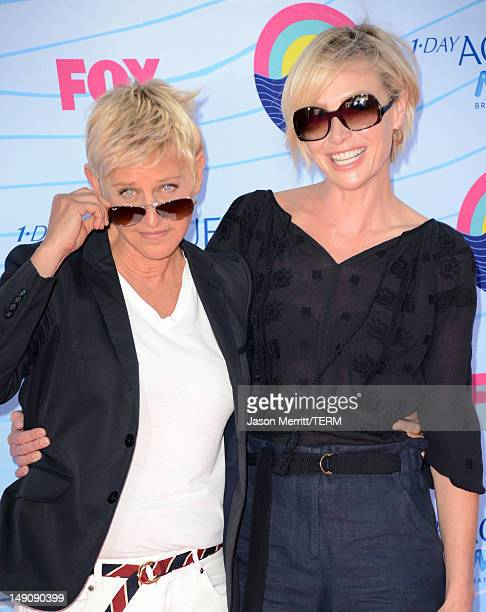 Personality Ellen DeGeneres and actress Portia de Rossi arrive at the 2012 Teen Choice Awards at Gibson Amphitheatre on July 22 2012 in Universal...