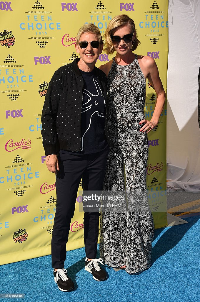 TV personality Ellen DeGeneres (L) and actress Portia de Rossi attend the Teen Choice Awards 2015 at the USC Galen Center on August 16, 2015 in Los Angeles, California.