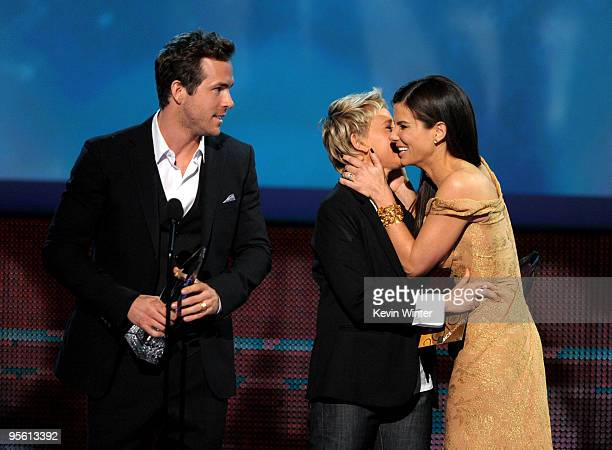 TV personality Ellen DeGeneres presents actor Ryan Reynolds and actress Sandra Bullock the Favorite Comedy Movie award for The Proposal onstage...