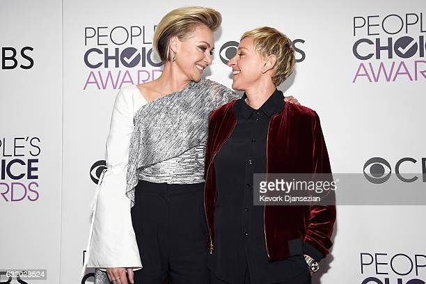 Personality Ellen Degeneres, winner of multiple awards and actress Portia De Rossi pose in the press room during the People's Choice Awards 2017 at...