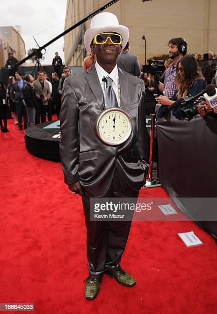 TV personality Flavor Flav arrives at the 2013 MTV Movie Awards at Sony Pictures Studios on April 14 2013 in Culver City California