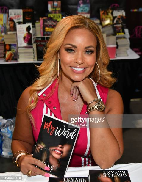 TV personality Gizelle Bryant signs copies of her new book My World during the 2019 Bronner Brothers International Beauty Show at the Georgia World...
