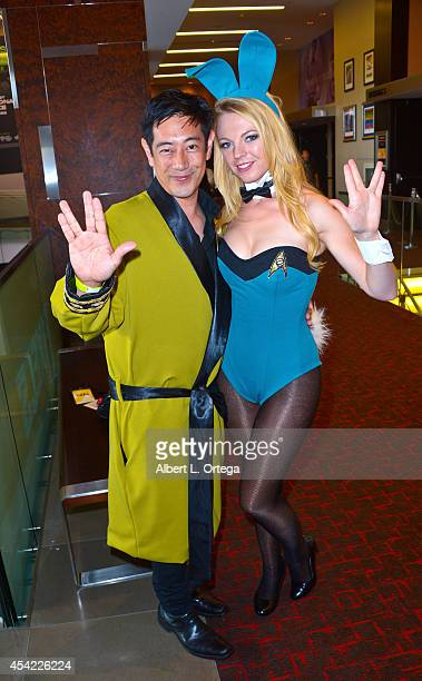 TV personality Grant Imahara and cosplayer Jennifer Newman dressed as a Star Trek Bunny posing for photos at the Hard Rock Hotel on Friday Day 2 of...