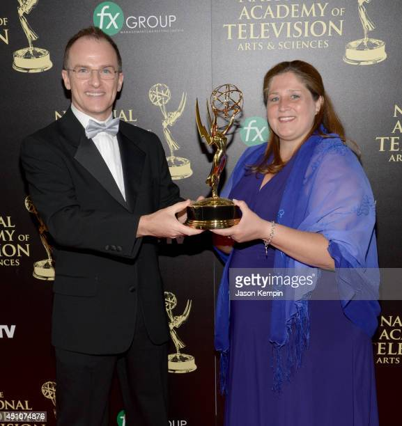 TV personality Guillermo Arduino and producer Magdalena Cabral poses with the Outstanding Entertainment Program in Spanish for 'Clix' Award in the...