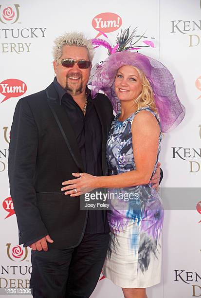TV personality Guy Fieri and wife Lori Fieri attend the 137th Kentucky Derby at Churchill Downs on May 7 2011 in Louisville Kentucky
