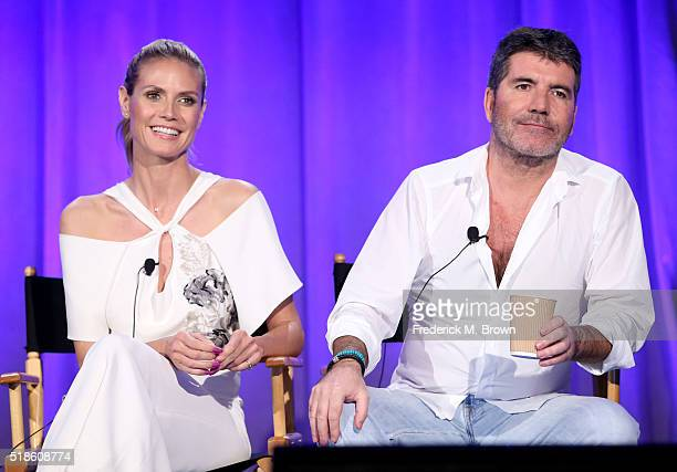 Personality Heidi Klum and producer/TV personality Simon Cowell speak onstage during the 'America's Got Talent' panel at the 2016 NBCUniversal Summer...