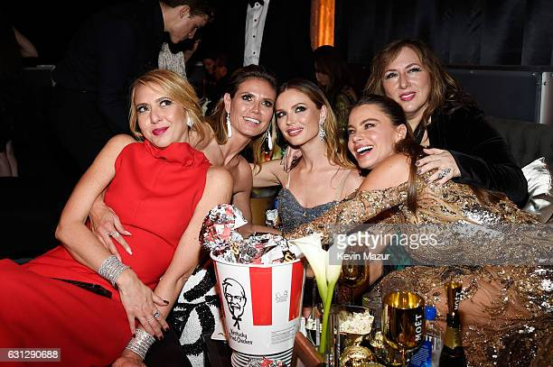 TV personality Heidi Klum designer Georgina Chapman and actress Sofia Vergara pose with guests at The Weinstein Company and Netflix Golden Globe...