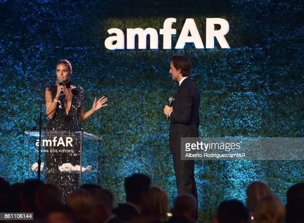 TV personality Heidi Klum speaks onstage with auctioneer Alexander Gilkes at the amfAR Gala 2017 at Ron Burkle's Green Acres Estate on October 13...