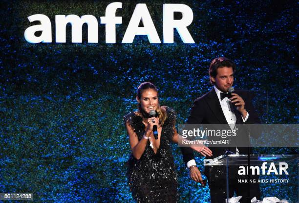 TV personality Heidi Klum speaks onstage with auctioneer Alexander Gilkes at the amfAR Gala Los Angeles 2017 at Ron Burkle's Green Acres Estate on...