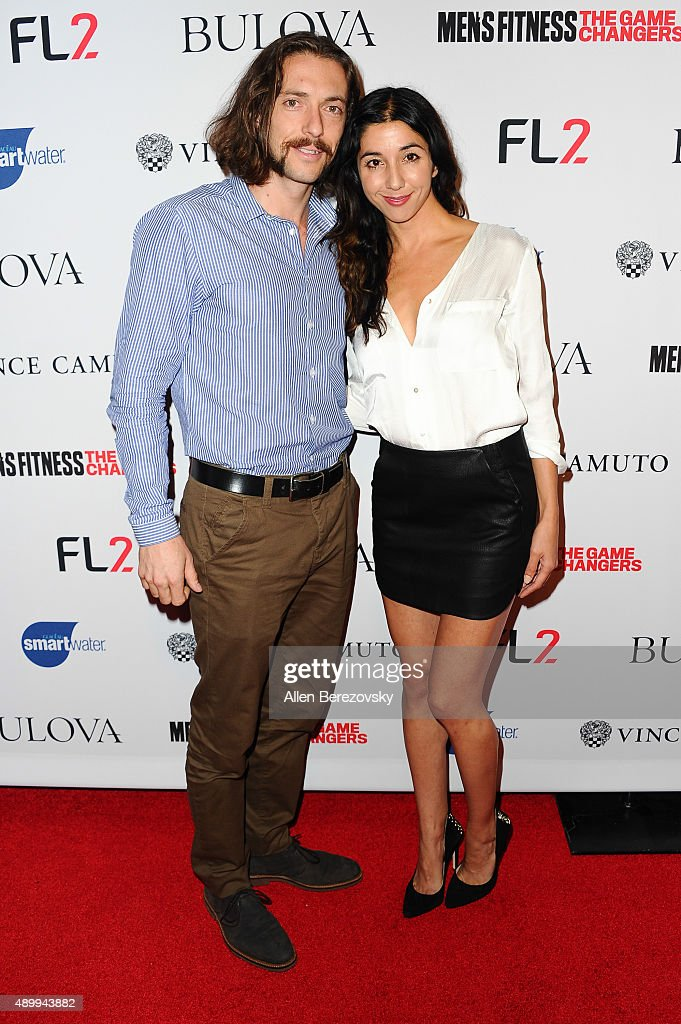 TV personality Isaac Caldiero (L) and Laura Kisana attend Men's Fitness Magazine Hosts Annual 'Game Changers' Celebration at Palihouse on September 24, 2015 in West Hollywood, California.