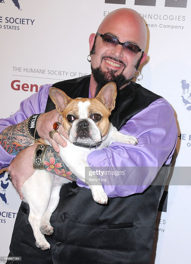 TV personality Jackson Galaxy and Beatrice the dog attend The Humane Society's 2013 Genesis Awards benefit gala at the Beverly Hilton Hotel on March 23, 2013 in Beverly Hills, California.
