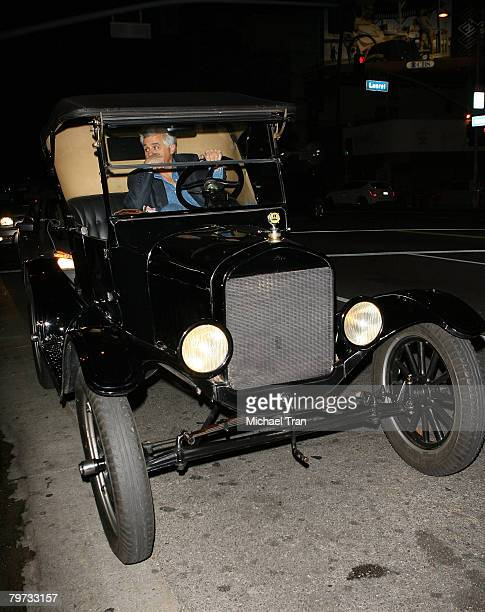 Personality Jay Leno arrives in his Ford Model T car at the A Wish for Animals standup comedy night at the Laugh Factory on February 12 2008 in West...
