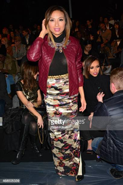 Personality Jeannie Mai attends the Reem Acra fashion show during MercedesBenz Fashion Week Fall 2014 at The Salon at Lincoln Center on February 10...