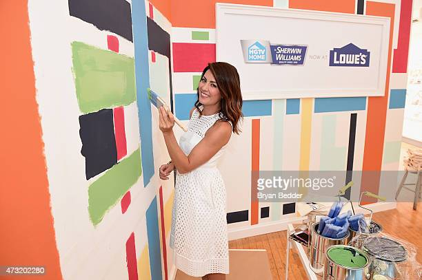 Personality Jillian Harris demonstrates the new HGTV HOME by SherwinWilliams paint collection at the HGTV HOME by SherwinWilliams and Lowe's NYC...