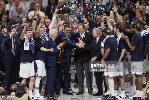 TV personality Jim Nantz and NCAA President Dr Mark Emmert speak to head coach Jay Wright of the Villanova Wildcats after defeating the Michigan...
