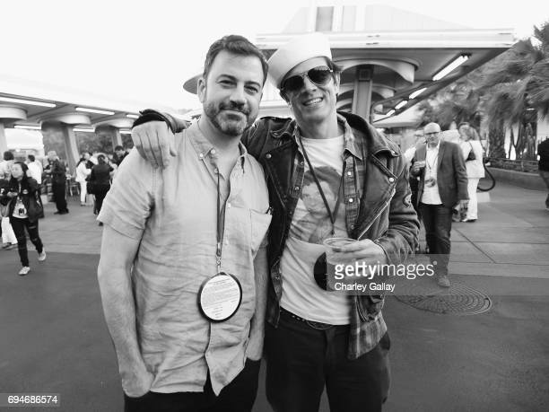 """TV personality Jimmy Kimmel and actor Johnny Knoxville pose at the after party for the World Premiere of Disney/Pixar's """"Cars 3"""" at Cars Land at..."""