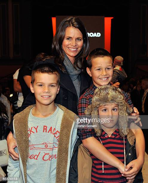 TV personality Jo Silvagni and her children pose on the catwalk following the Country Road collection show during the Fashion Collections Mini Me...