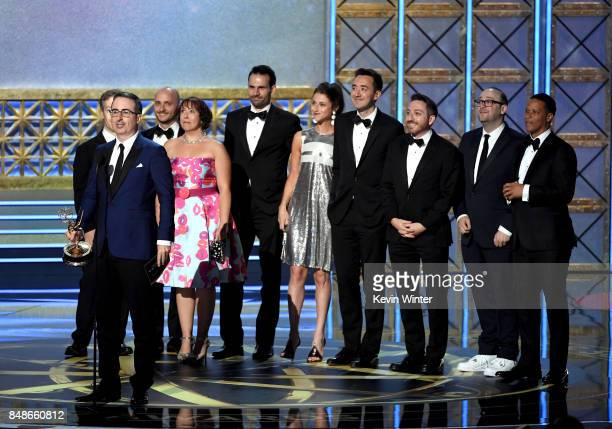 TV personality John Oliver and writing staff accept the Outstanding Writing for a Variety Series for Last Week Tonight with John Oliver onstage...