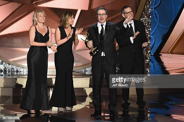 Personality John Oliver , writer/producer Tim Carvell and the production team accept the award for Outstanding Variety Talk Series for 'Last Week...