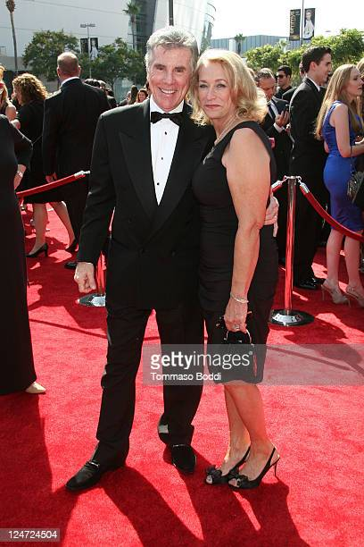 TV personality John Walsh and Reve Walsh attend the 2011 Primetime Creative Arts Emmy Awards at Nokia Theatre LA Live on September 10 2011 in Los...