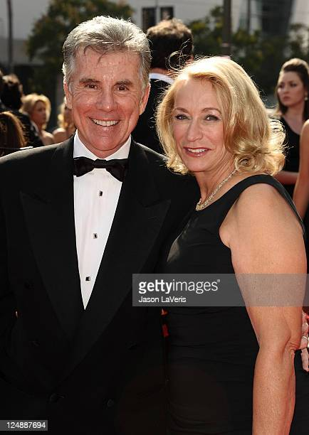 TV personality John Walsh and wife Reve Walsh attend the 2011 Creative Arts Emmy Awards at Nokia Theatre LA Live on September 10 2011 in Los Angeles...