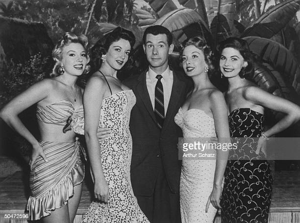TV personality Johnny Carson flanked by four Carson Cuties from an early TV show called The Johnny Carson Show not to be confused with The Tonight...