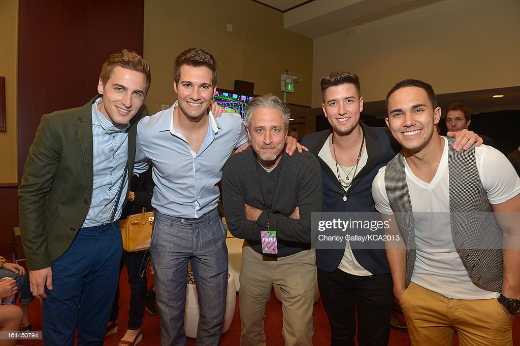 TV personality Jon Stewart (C) with singers Kendall Schmidt, Jason Maslow, Logan Henderson and Carlos Pena Jr. of Big Time Rush seen backstage at Nickelodeon's 26th Annual Kids' Choice Awards at USC Galen Center on March 23, 2013 in Los Angeles, California.
