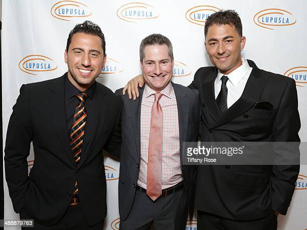 TV personality Josh Altman chairman of Lupus LA Adam Selkowitz and TV personality Dennis Desantis attend the Lupus LA Orange Ball on May 8 2014 in...
