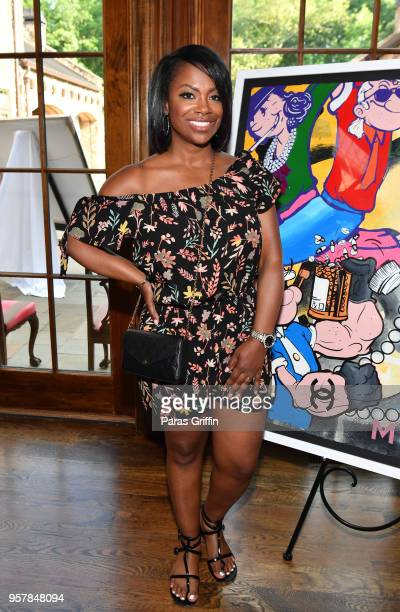 TV personality Kandi Burruss attends Exhibit Gray on May 12 2018 in Atlanta Georgia