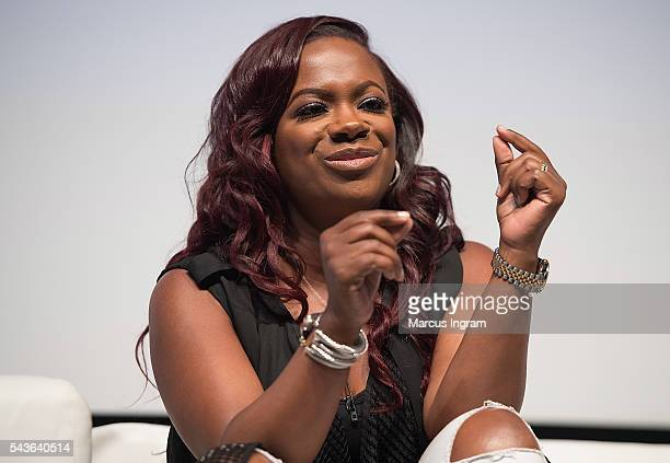 Personality Kandi Burruss-Tucker speaks on stage during the 2016 Dream Symposium at Porter Sanford III Performing Arts & Community Center on June 29,...