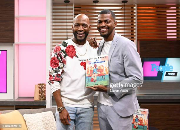 """Personality Karamo Brown and son Jason Brown pose with their new book """"I am Perfectly Designed"""" at PeopleNow at PeopleTV Studios on November 06, 2019..."""
