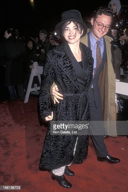 TV Personality Karen Duffy and husband John Lambros attend 'The Boxer' New York City Premiere on January 7 1998 at Coronet Theater in New York City...