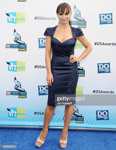 Personality Karina Smirnoff arrives at the DoSomething.org And VH1's 2012 Do Something Awards at the Barker Hangar on August 19, 2012 in Santa...